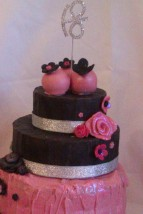 close-up-pink-and-black-chocolate-cake-with-cake-pops