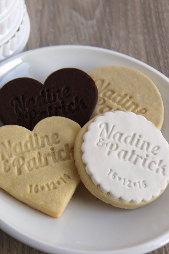 personalised cookies with the newleyweds names and wedding date make pretty and personal wedding favours